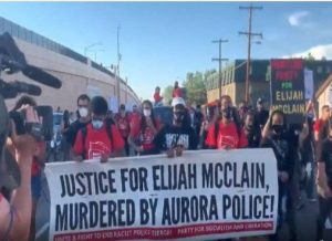 """"""" Hundreds march for justice for Elijah McClain from memorial to Aurora police district """""""